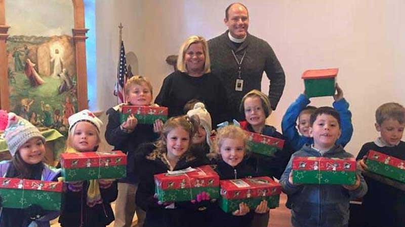 children with service project boxes